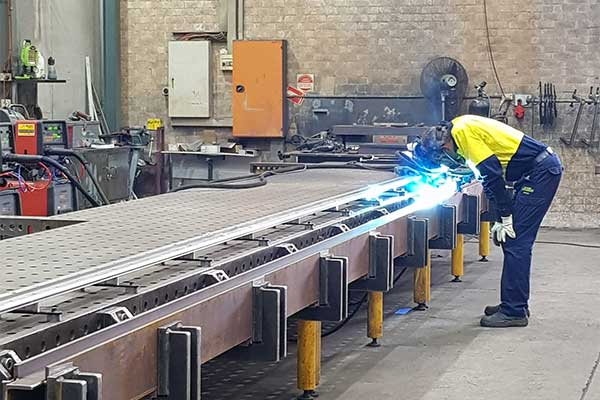 Metal fabrication services including repair and straightening